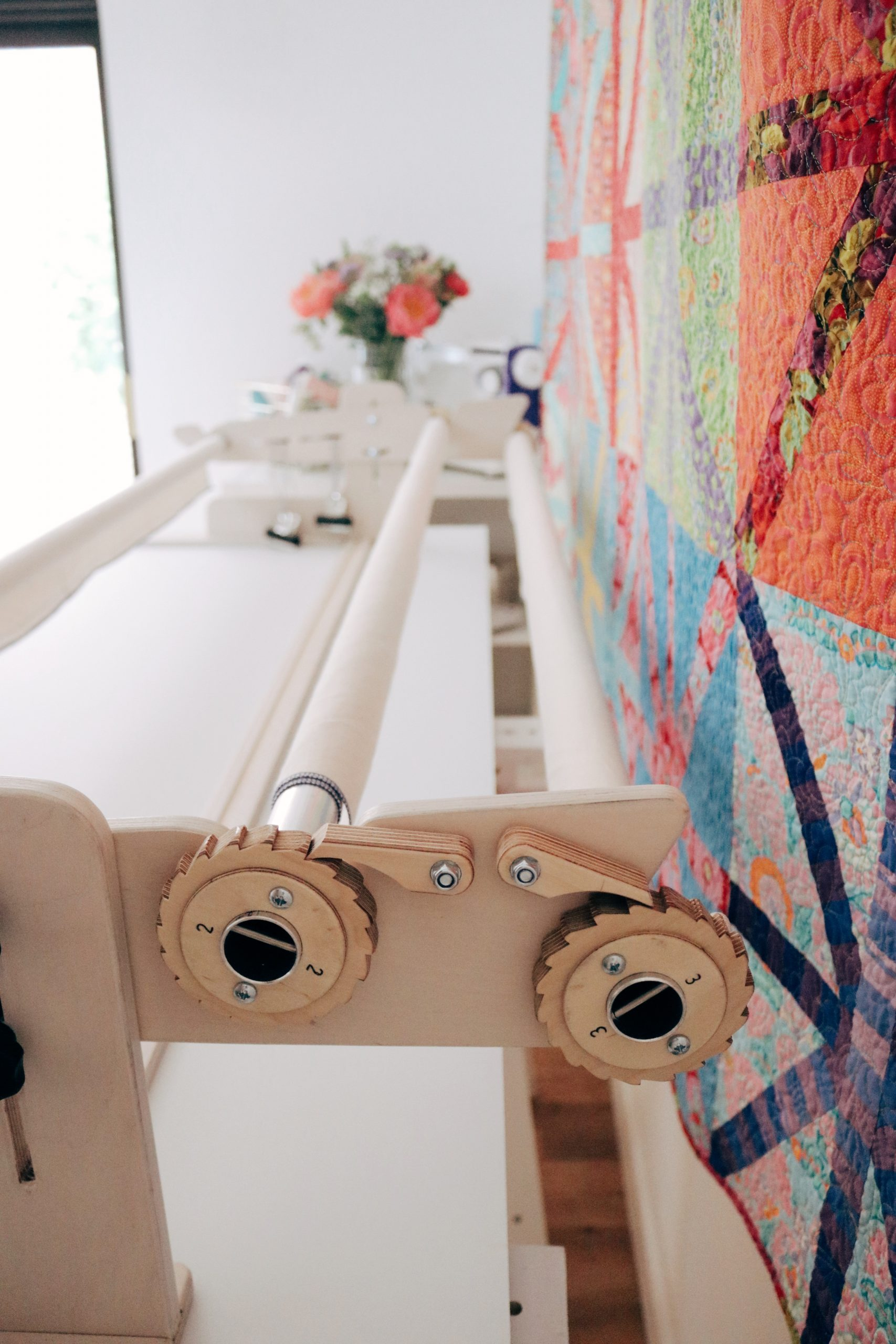 Beautiful end pieces and pole design updated to allow you to move seamlessly between quilting frame sizes.